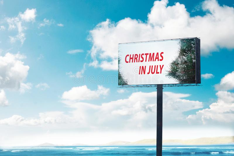 Billboard with text Christmas in July royalty free stock photo