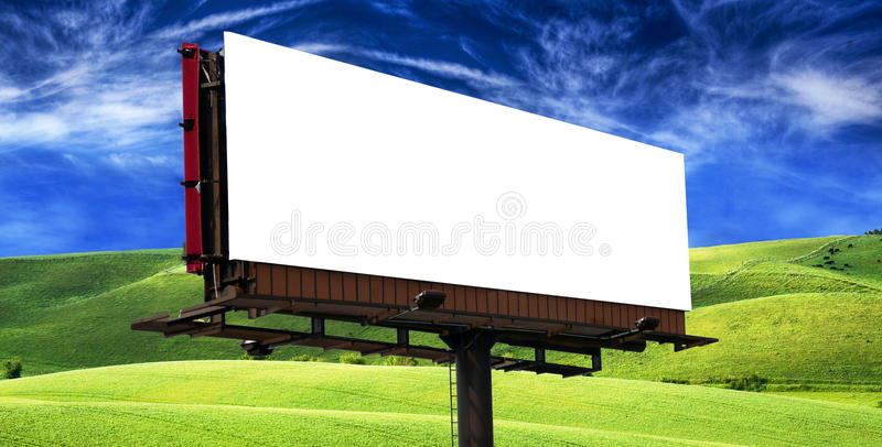 Billboard under a blue sky royalty free stock photography