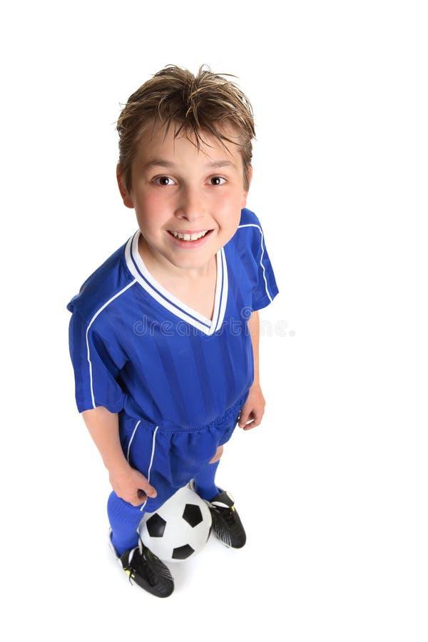 Bille de football de wth de garçon images stock