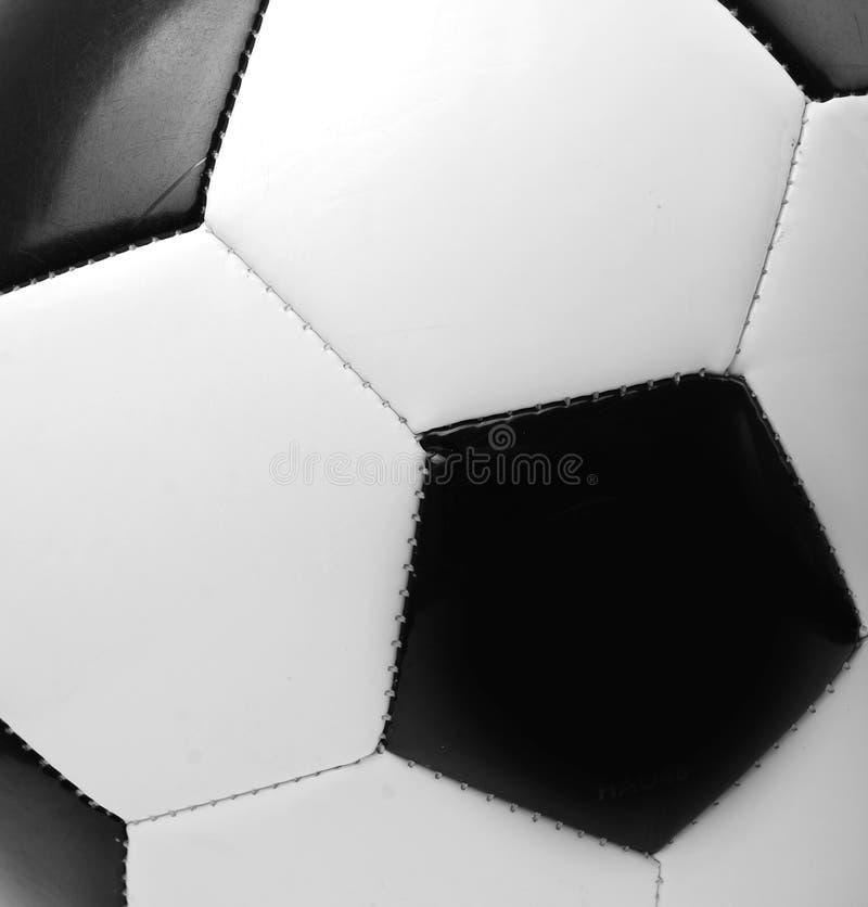 Bille de football noire et blanche photos stock