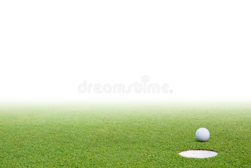 Bille de golf et herbe verte image libre de droits
