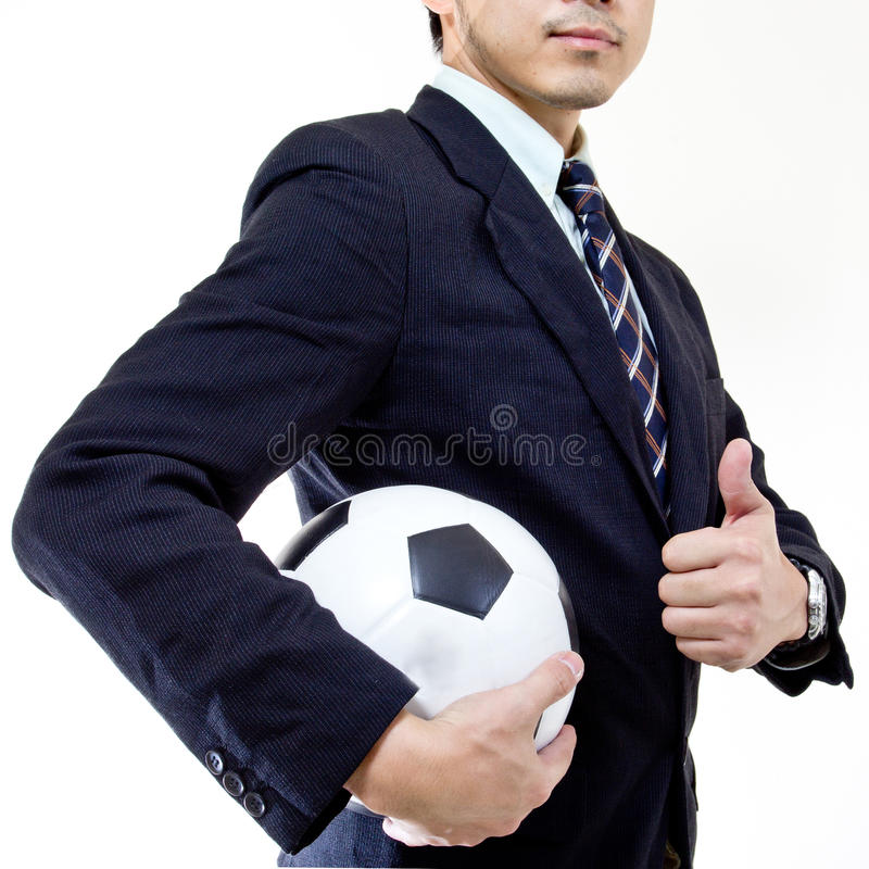 Bille de prise de gestionnaire du football avec ses mains photos stock
