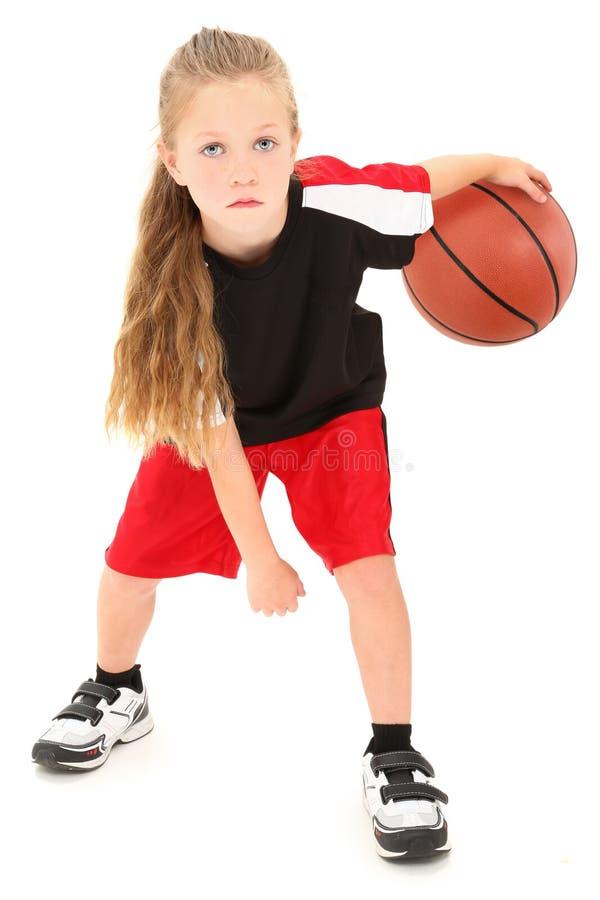 Bille de ruissellement de joueur de basket d'enfant de fille photographie stock