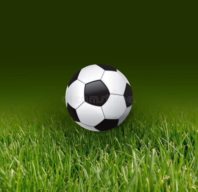 Bille et herbe de football image stock