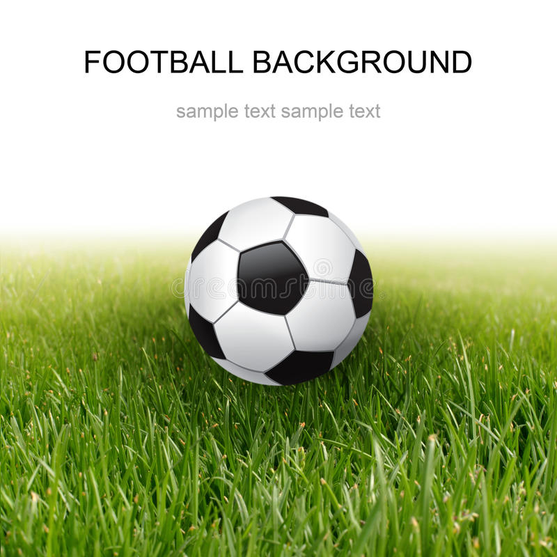 Bille et herbe de football photo stock