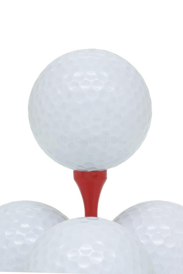 Billes et té de golf photo stock