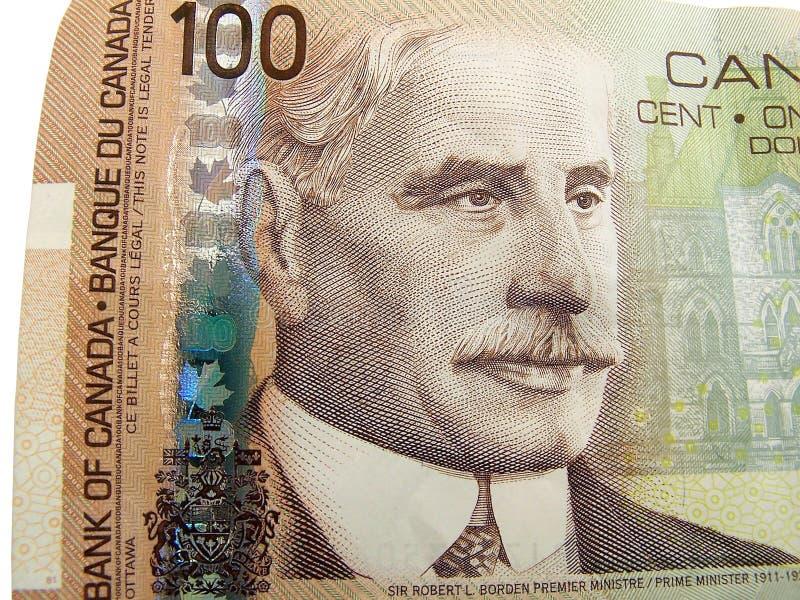 Billet d'un dollar du Canadien 100 photo libre de droits