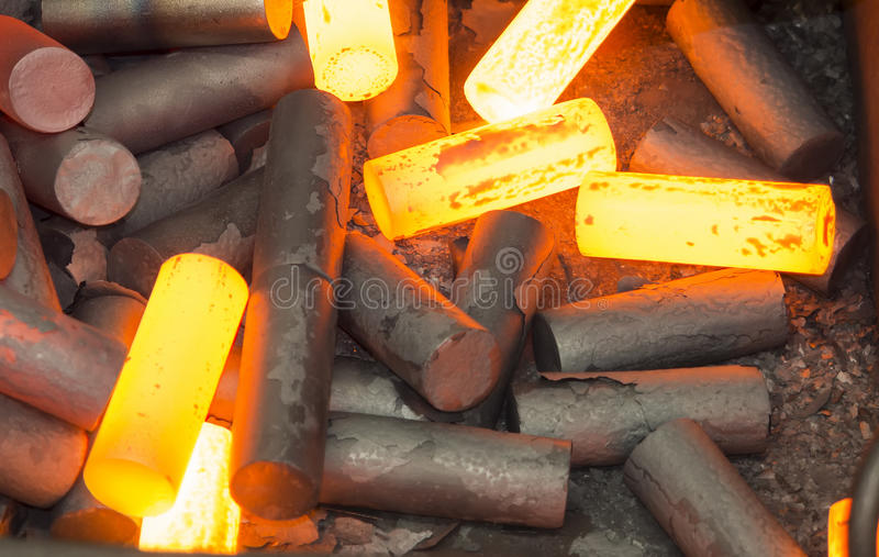 Billet heating for hot forging. Billet heating by induction furnace for hot forging stock photography