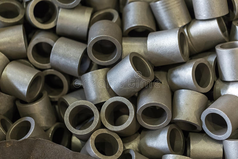 Billet steel parts in the shop of engineering plant in large qua. Metal parts, steel. Steel rollers, rollers. Billet steel parts in the shop of engineering plant royalty free stock photo