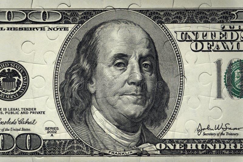 Billete de banco 100 dólares de rompecabezas Fondo imagen de archivo