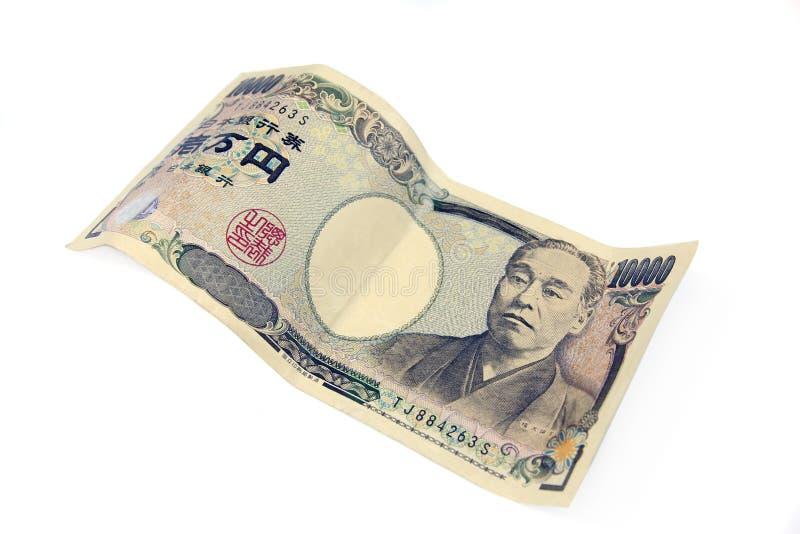 Billete de banco de diez yenes del tousand en el fondo blanco foto de archivo