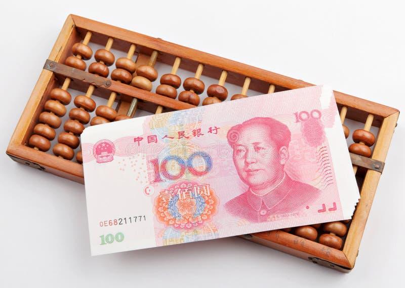 Billete de banco del ábaco y del dinero de China fotos de archivo