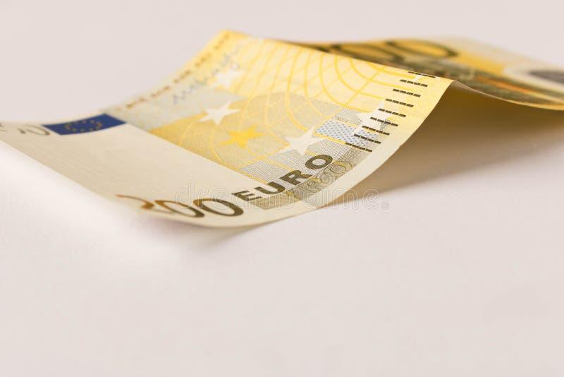 Billete de banco del euro 200 en un fondo ligero Cierre para arriba El concepto de ahorros fotografía de archivo