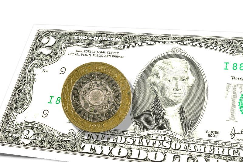 billete de banco de 2 nosotros-dólares con 2 libras esterlinas arriba foto de archivo