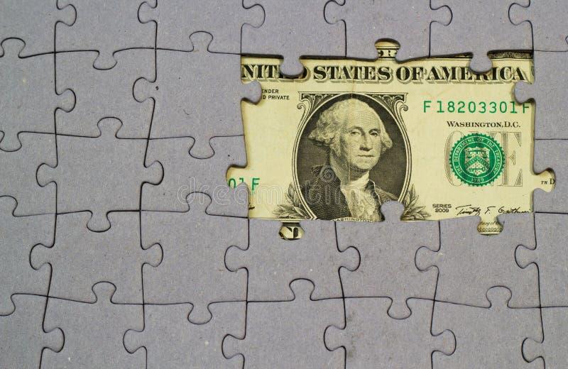 Billete de banco y rompecabezas del dólar de EE. UU. imagenes de archivo