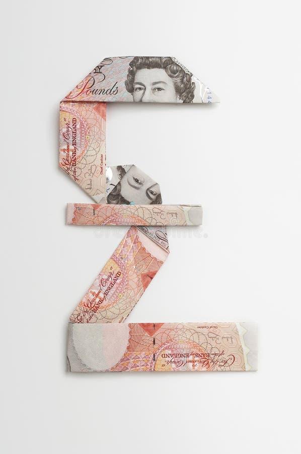 Billetes de banco de Sterling Symbol Made Of Folded de la libra fotografía de archivo libre de regalías