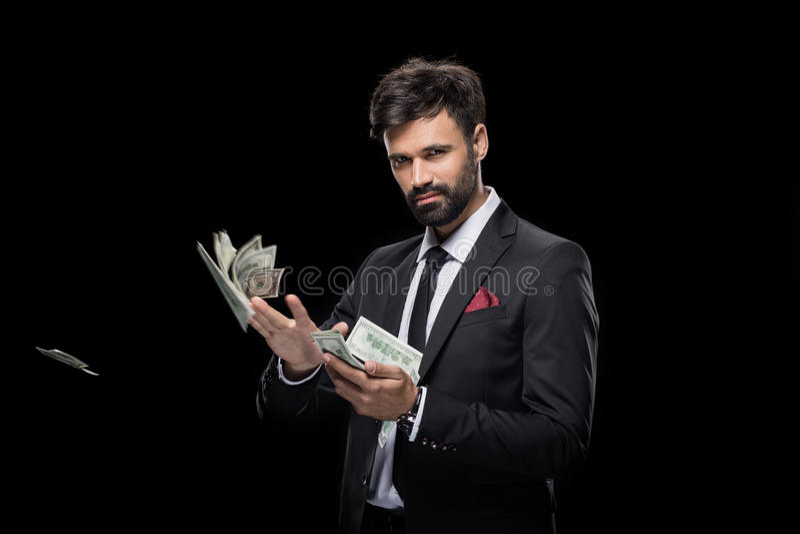 Billetes de banco del dólar del hombre de negocios que lanzan rico hermoso foto de archivo
