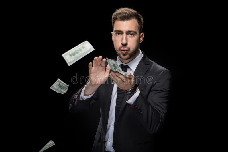 Billetes de banco del dólar del hombre de negocios que lanzan rico hermoso fotografía de archivo