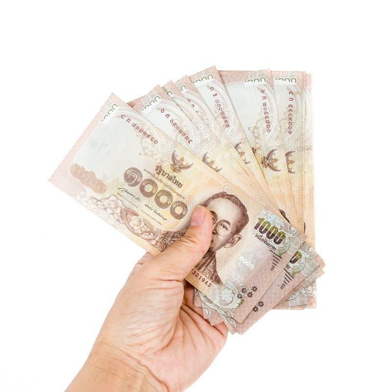 Billetes de banco del dinero de Tailandia a disposición del hombre fotografía de archivo libre de regalías