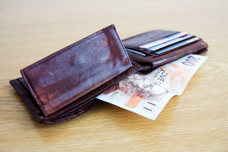 Billetes de banco en cartera foto de archivo