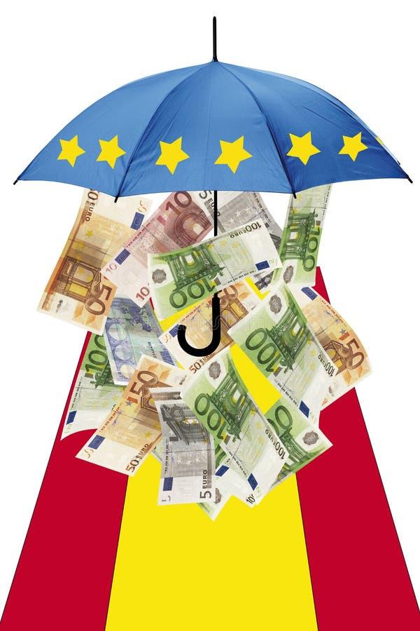 Billetes de banco euro debajo del paraguas con la bandera española imagen de archivo
