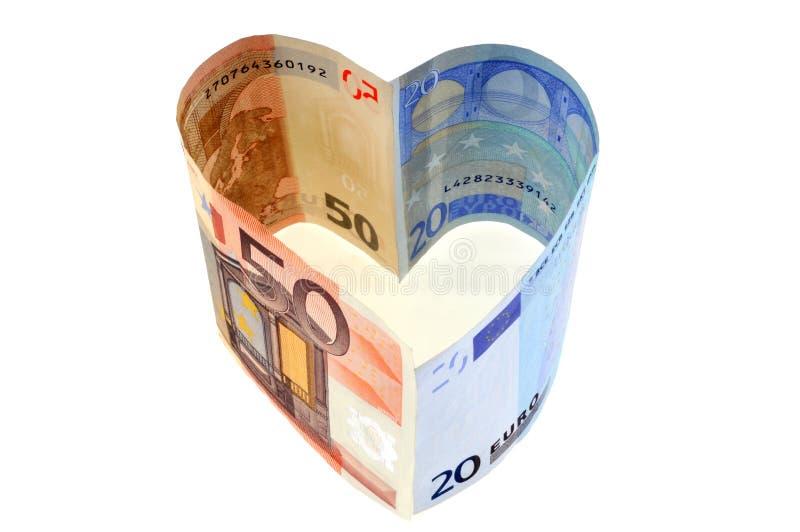 Billetes de banco euro en forma del corazón en el fondo blanco foto de archivo libre de regalías