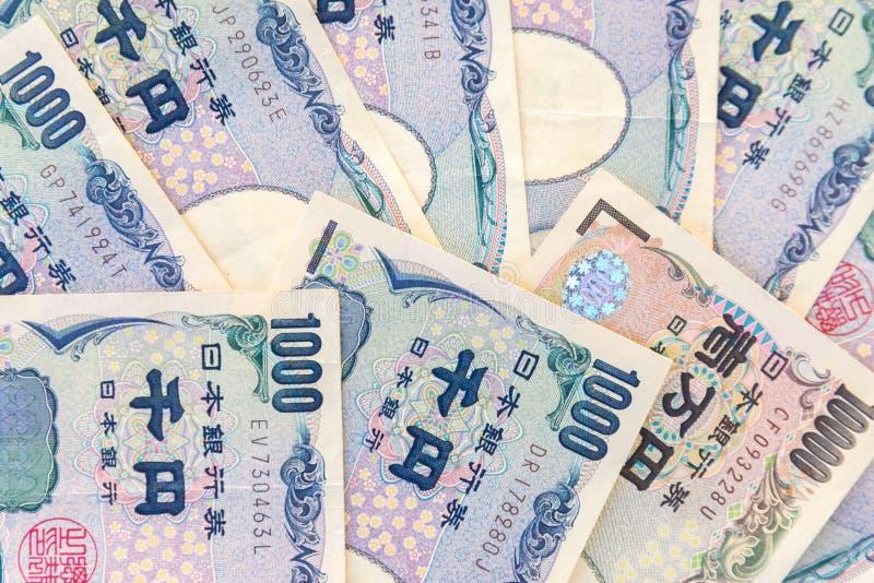 Billetes de banco japoneses de los yenes de la moneda del primer fotos de archivo