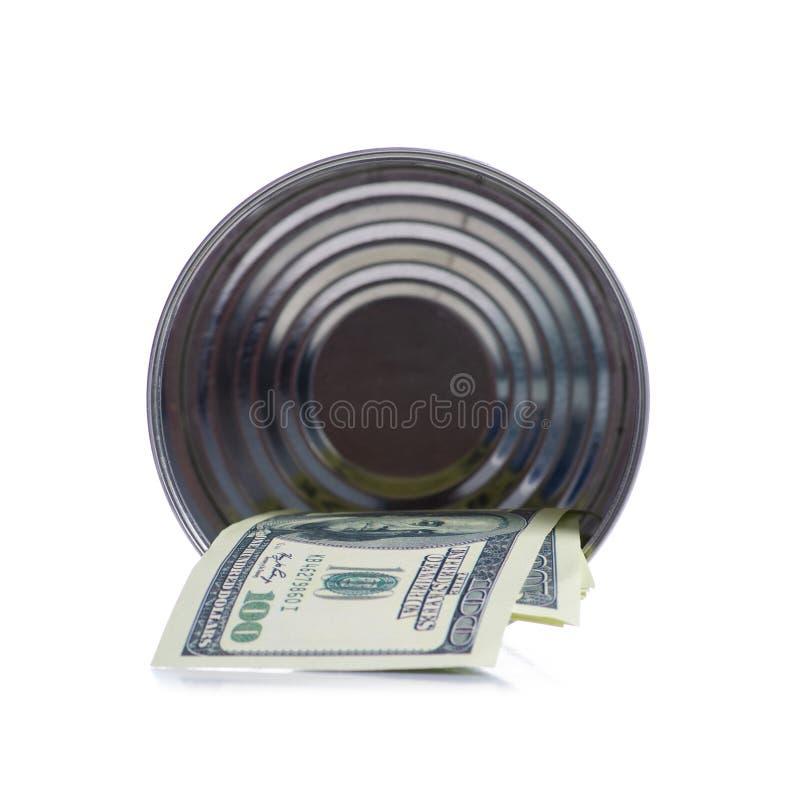 Billetes de banco de los dólares del dinero en el tarro de la lata aislado en el fondo blanco fotografía de archivo libre de regalías