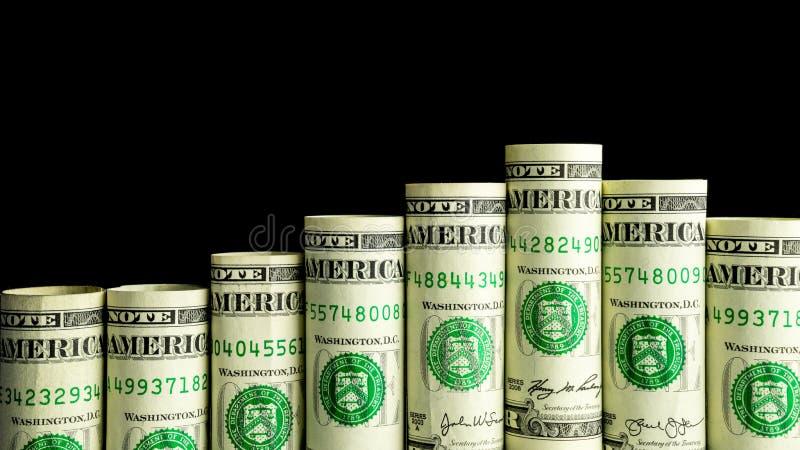 Billetes de banco rodados aislados con el fondo negro foto de archivo libre de regalías