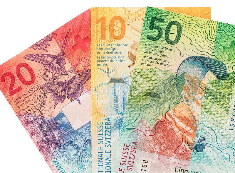 Billetes de banco suizos en el fondo blanco foto de archivo