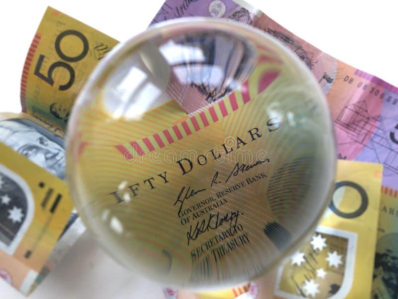 Billetes de banco y bola de cristal australianos fotografía de archivo