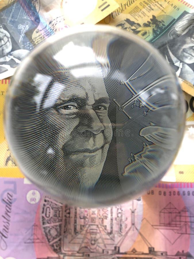Billetes de banco y bola de cristal australianos foto de archivo libre de regalías