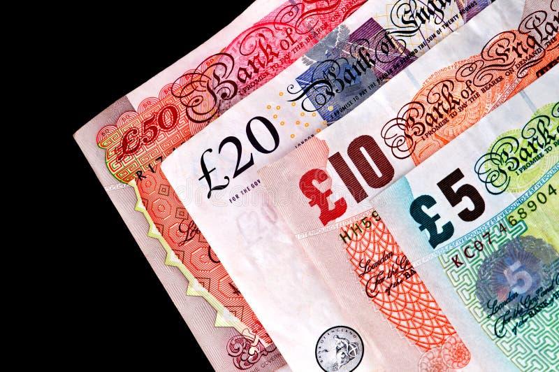 Billetes del dinero en circulación BRITÁNICO - billetes de banco. imagenes de archivo