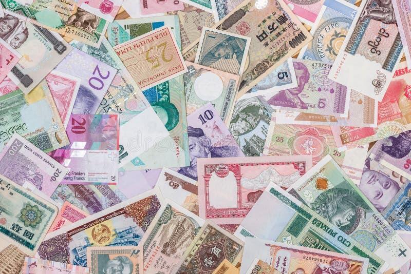 Billetes del mundo como fondo fotos de archivo libres de regalías