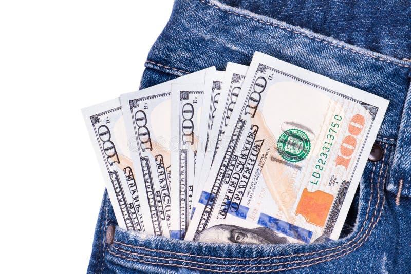Billets d'un dollar américains dans des jeans photographie stock