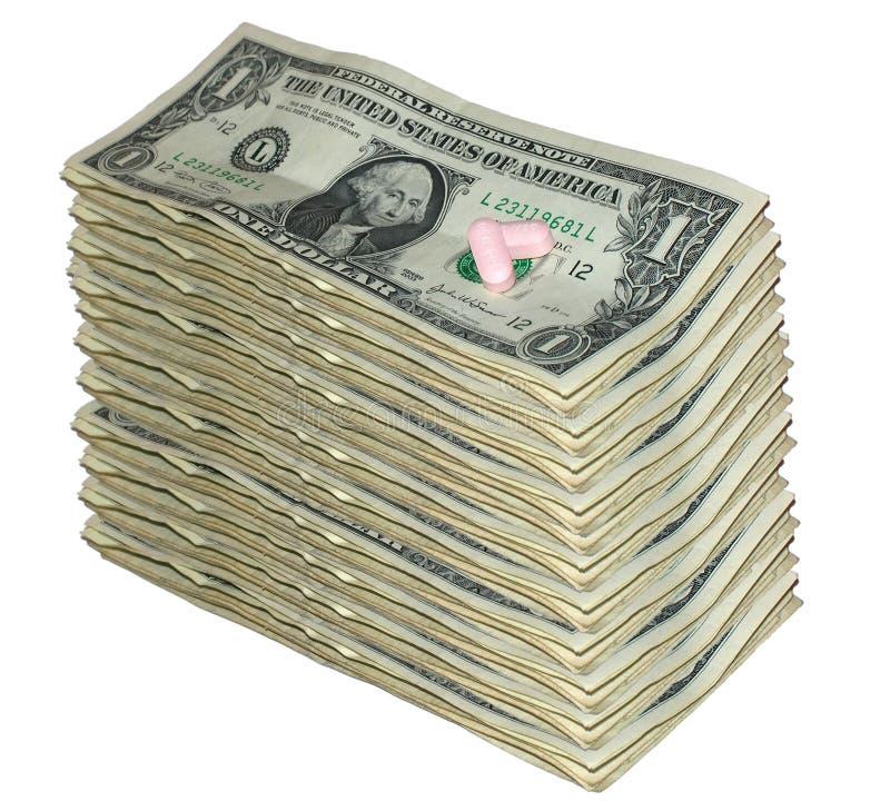 Billets d'un dollar et pillules photo libre de droits