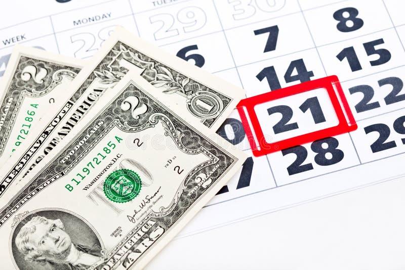Billets d'un dollar sur le calendrier images stock