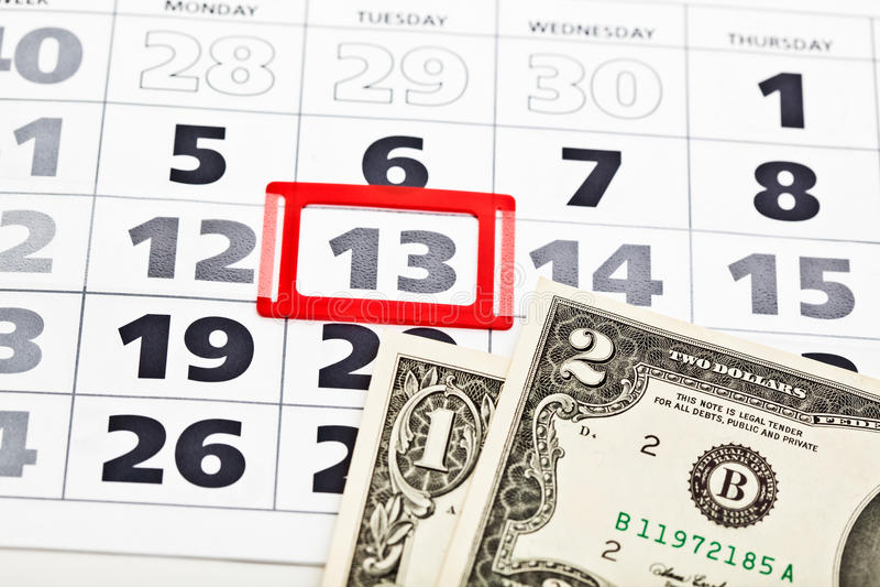 Billets d'un dollar sur le calendrier photographie stock libre de droits
