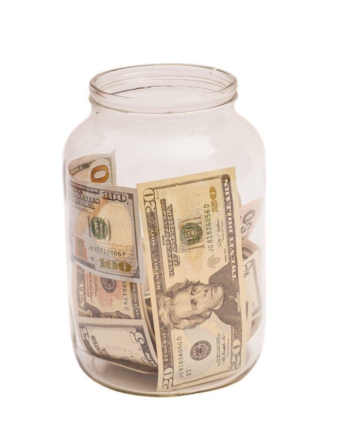 Billets de banque de dollar US dans le pot photographie stock