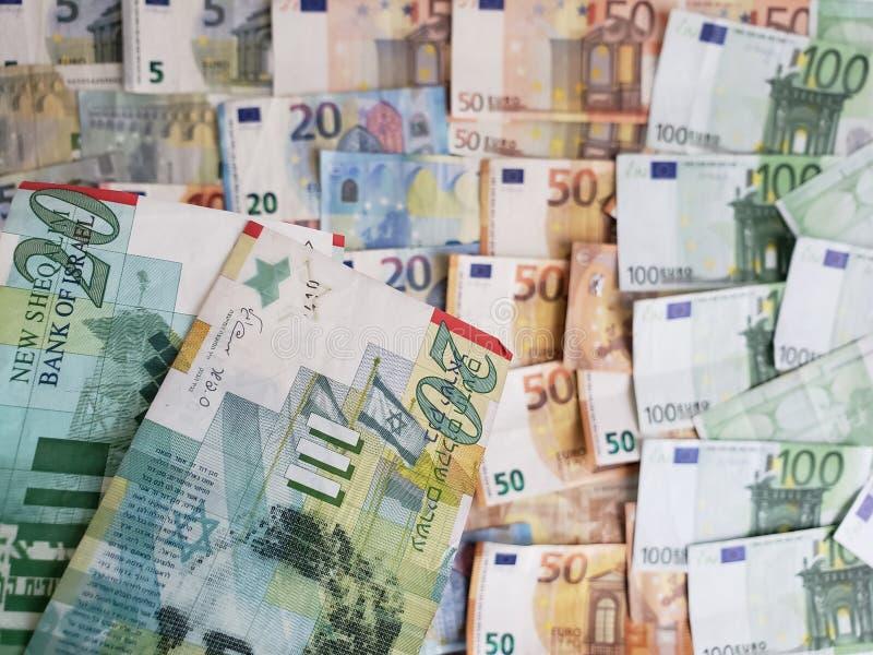 Billets de banque et factures israéliens d'euro photos libres de droits