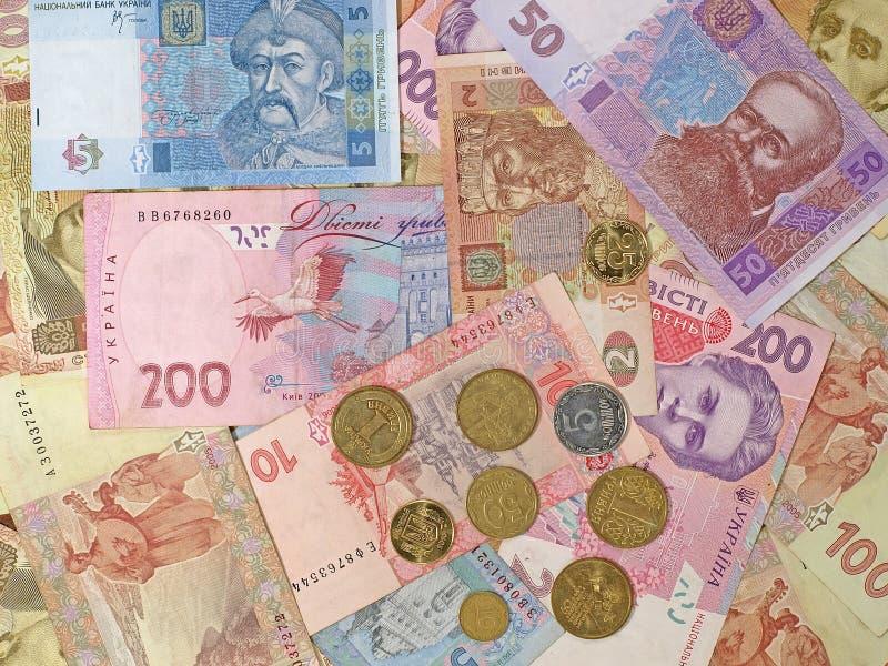Billets de banque et pièces de monnaie ukrainiens. photo libre de droits