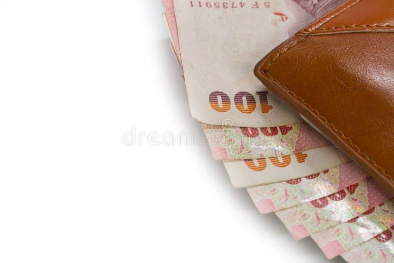 Billets de banque thaïlandais dans un portefeuille sur le fond blanc photographie stock