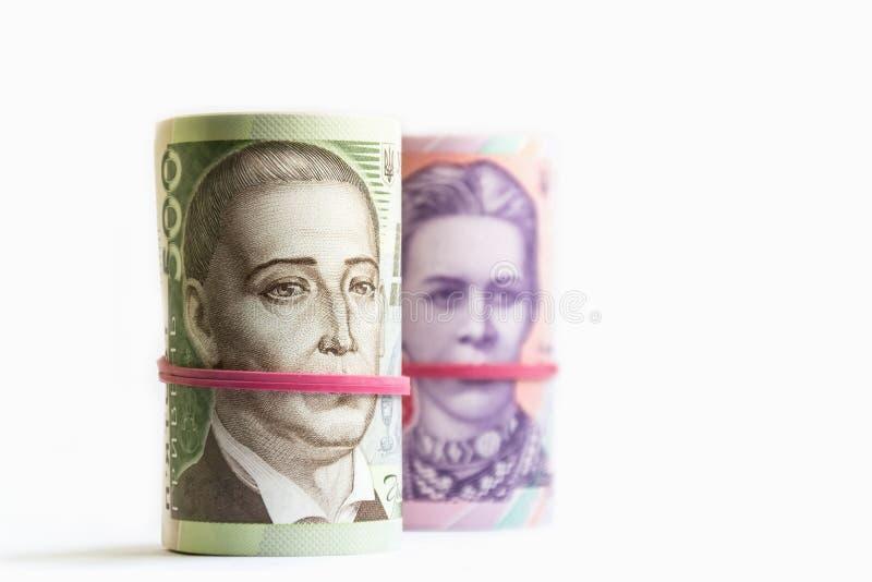 Billets de banque ukrainiens de hryvnia deux et cinq cents dans des tubes Symbole de corruption photos libres de droits