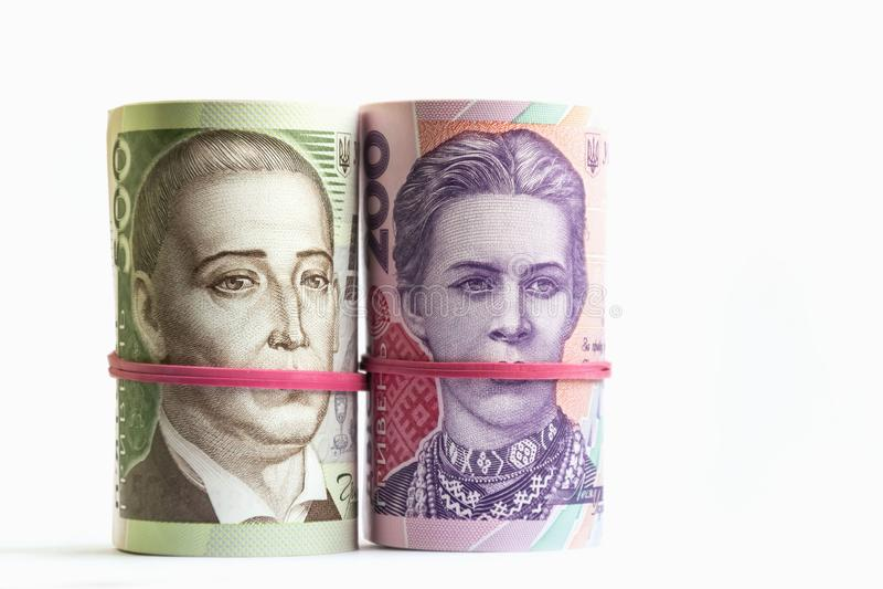 Billets de banque ukrainiens de hryvnia deux et cinq cents dans des tubes Symbole de corruption images libres de droits