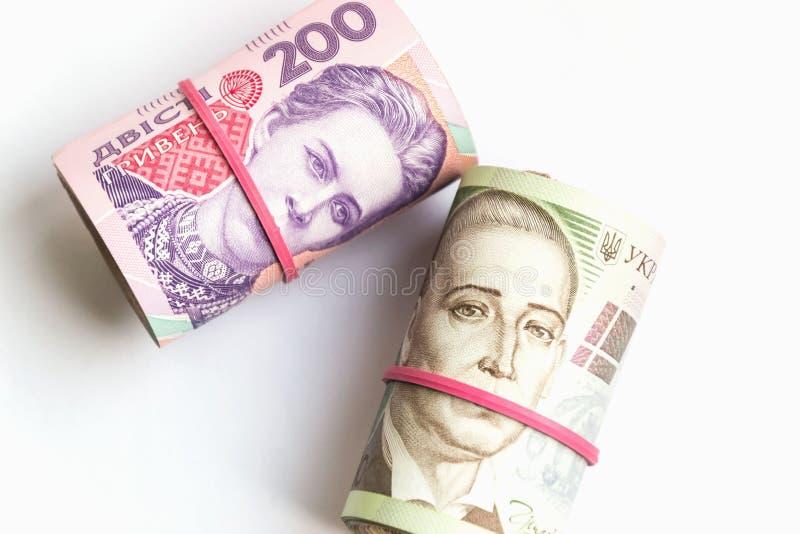 Billets de banque ukrainiens de hryvnia deux et cinq cents dans des tubes Symbole de corruption photo stock