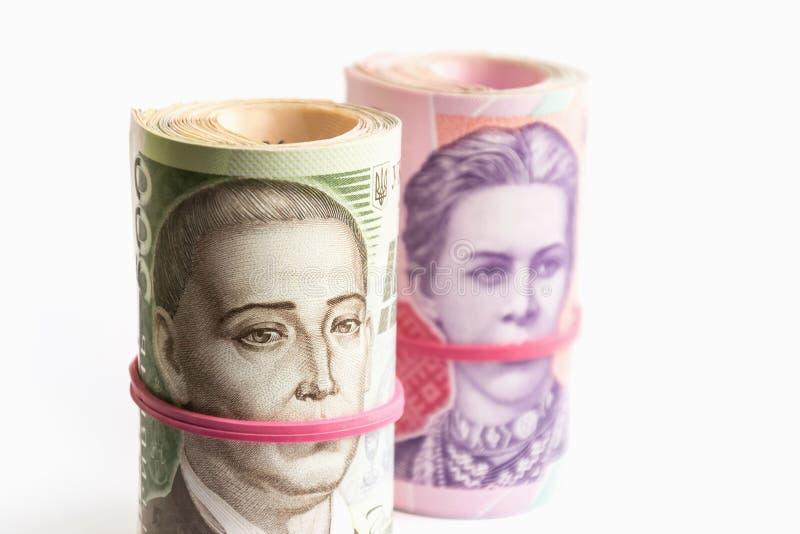 Billets de banque ukrainiens de hryvnia deux et cinq cents dans des tubes Symbole de corruption photo libre de droits