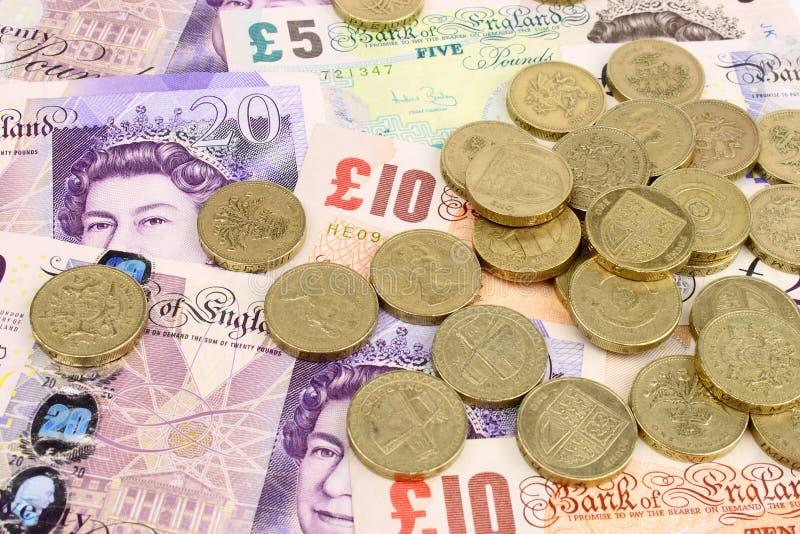 Billets et monnaie sterling photographie stock