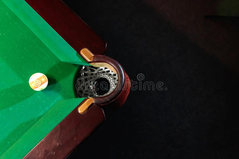 Billiard ball near the pockets on the billiard table, top view, American billiards. Sports games, outdoor activities.  stock images