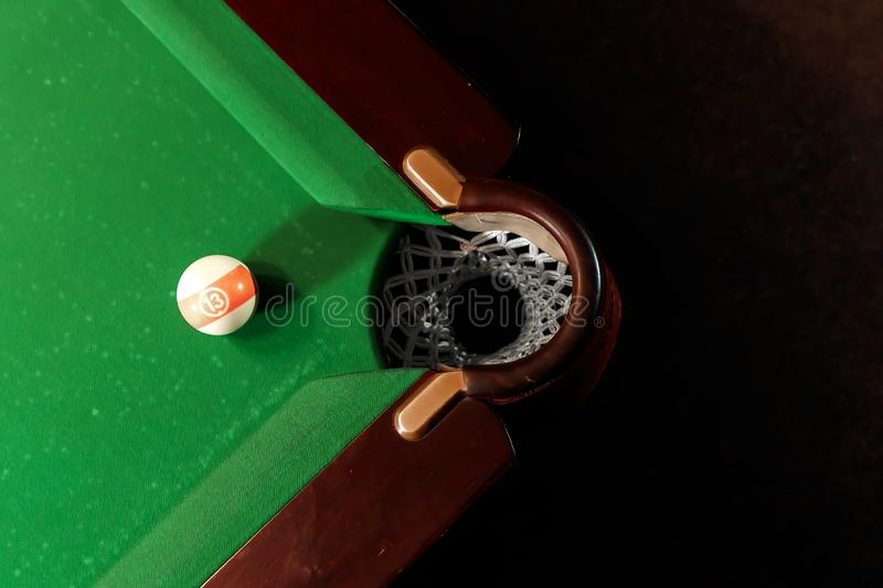 Billiard ball near the pockets on the billiard table, top view, American billiards. Sports games, outdoor activities.  royalty free stock photo