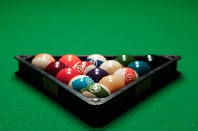 Billiard ball in the triangle on the billiard table, American billiards. Sports games, outdoor activities.  stock photos